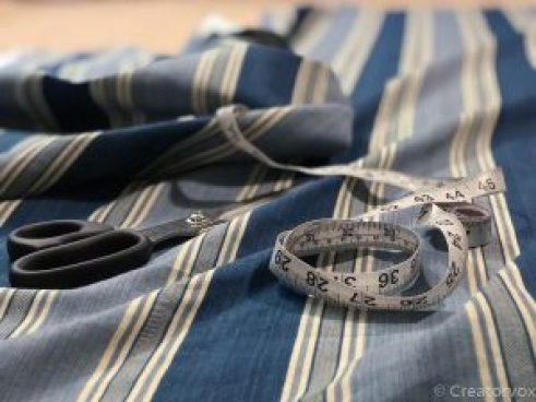 uncut fabric, scissors, and tape measure