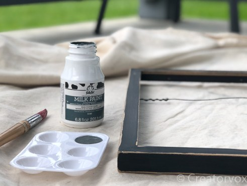 menu board frame with paint and brush