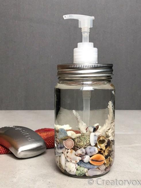 mason jar soap dispenser with seashell display