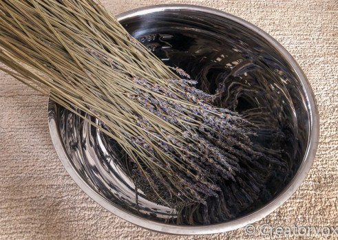 remove blossoms for lavender sachets into a large bowl