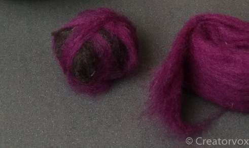 adding purple color to felted soap