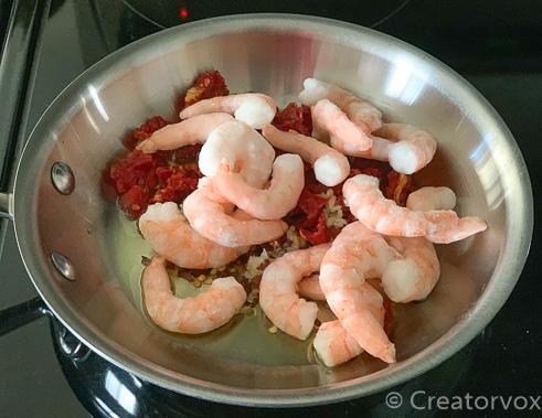 all ingredients for shrimp pasta in saute pan