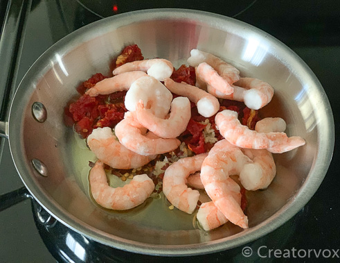all ingredients for shrimp pasta in saute pan