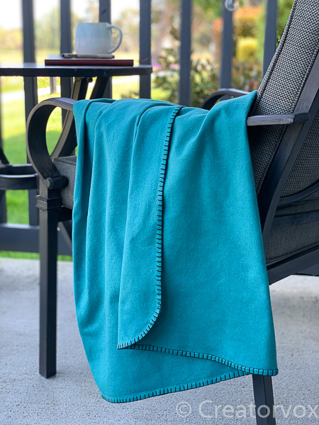 eco friendly blanket on an outdoor chair