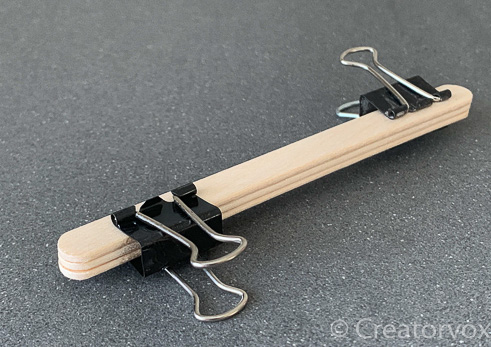 use binder clips to clamp the craft sticks together while the glue dries