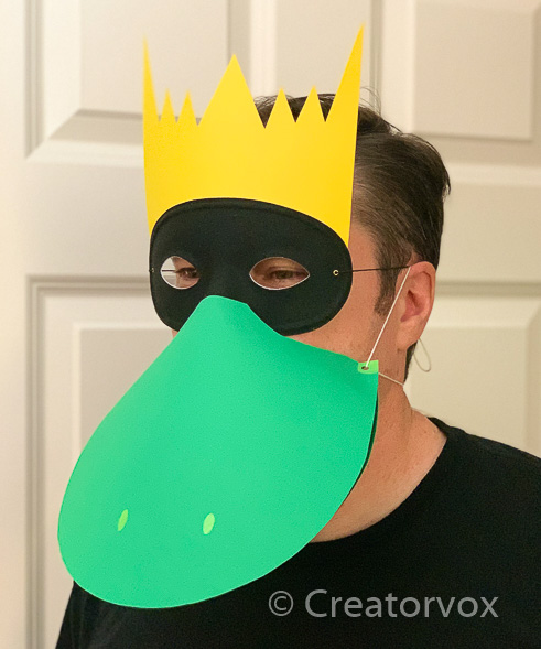 paper frog prince mask with green bill and yellow crown