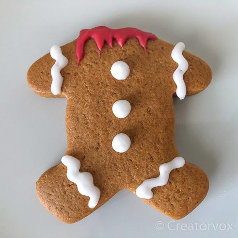 spooky headless gingerbread man cookie