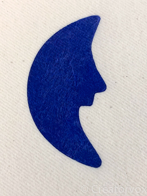 finished half moon stencil on flannel fabric
