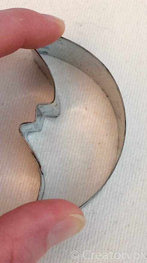 cookie cutter held in place for painted receiving blanket design