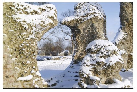 The ancient Abbey in the snow in winter Xb