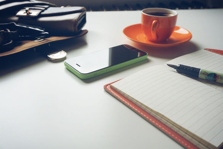 Table with coffee and wallet