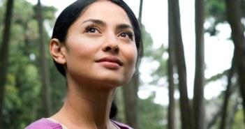 Woman thinking about Mutual Funds