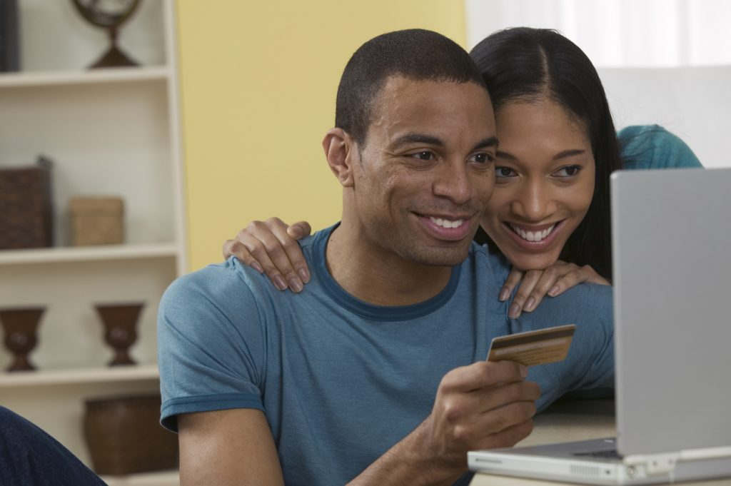 Couple is researching online to learn how to avoid common balance transfer mistakes.
