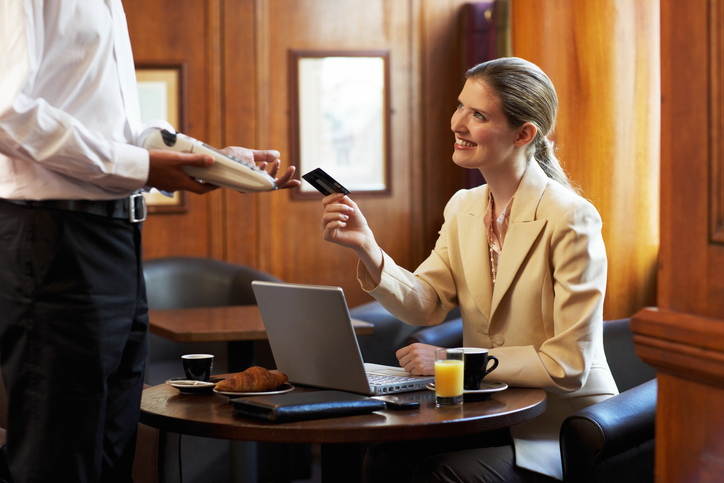 How do small business credit cards impact a personal credit score?