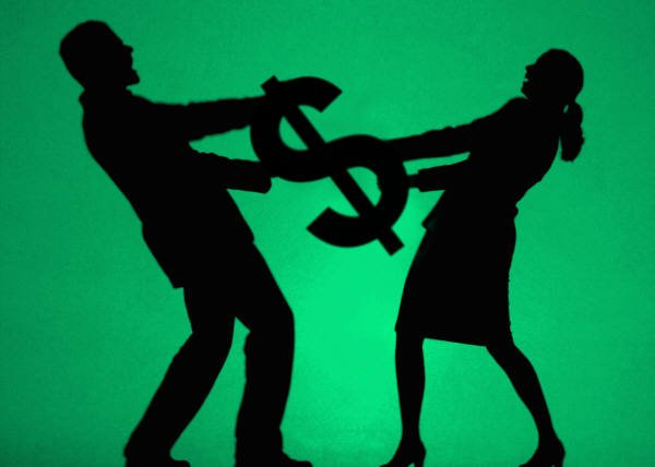 Two People Tugging on $ Sign