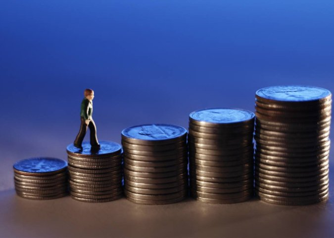 Businessman Figure Ascending Stack of Coins