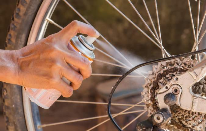 Spraying WD-40 on Bicycle Gears