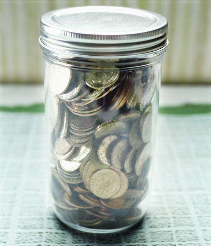 Coins in a Glass Jar --- Image by © Royalty-Free/Corbis