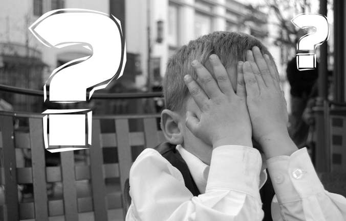 Child Covering Face with Question Mark