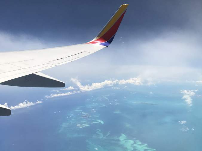 Plane Flying Over Coral Reef