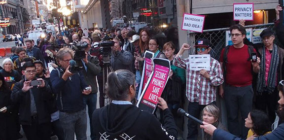 """Electronic Frontier Foundation protest, with members holding signs that say """"Secure Phones Save Lives"""" and """"Privacy Matters"""""""