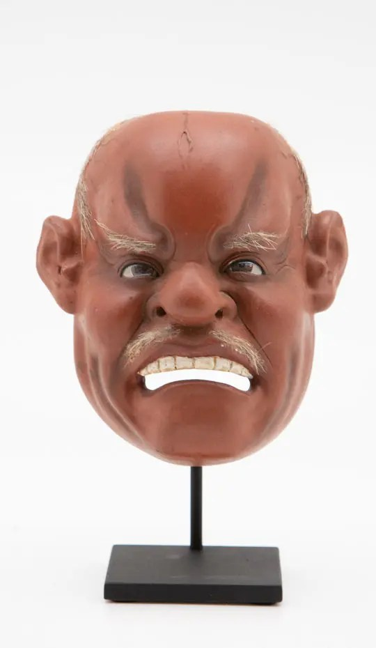 Medium Japanese Papier-Mâché Mask of an angry man Mounted on Custom Painted Metal Base