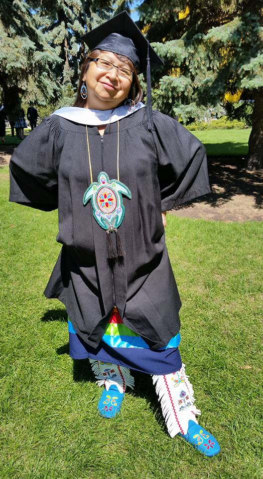 Showing off her graduation high-tops, designed by Patricia Piche: That's walking in both worlds!