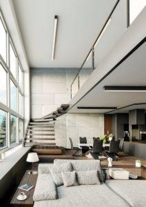 Apartament w stylu nowoczesnym z betonowym wykonczeniem i ociepleniem drewnianym
