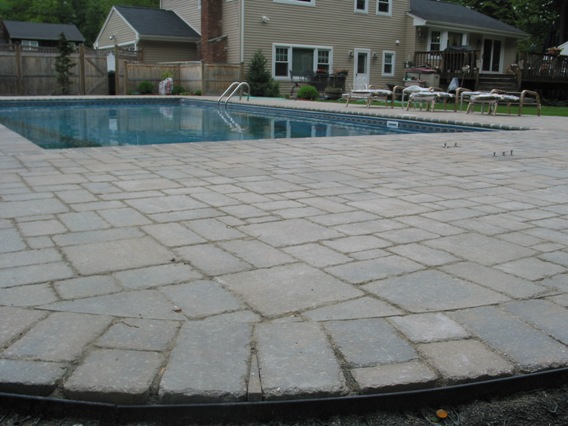 nice-pavers-patio-tech-bloc-with-pool-inbetween