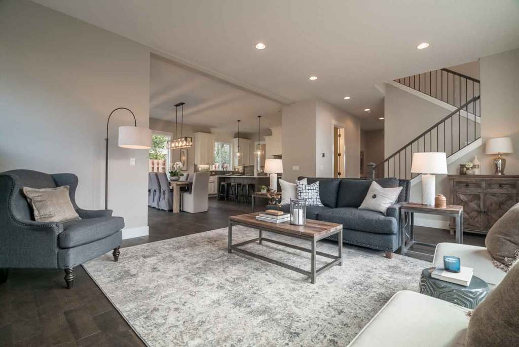 Built by general contractor, Crescent Homes Maui, this great room includes a living room, dining room, custom kitchen, and stairs going to 2nd floor