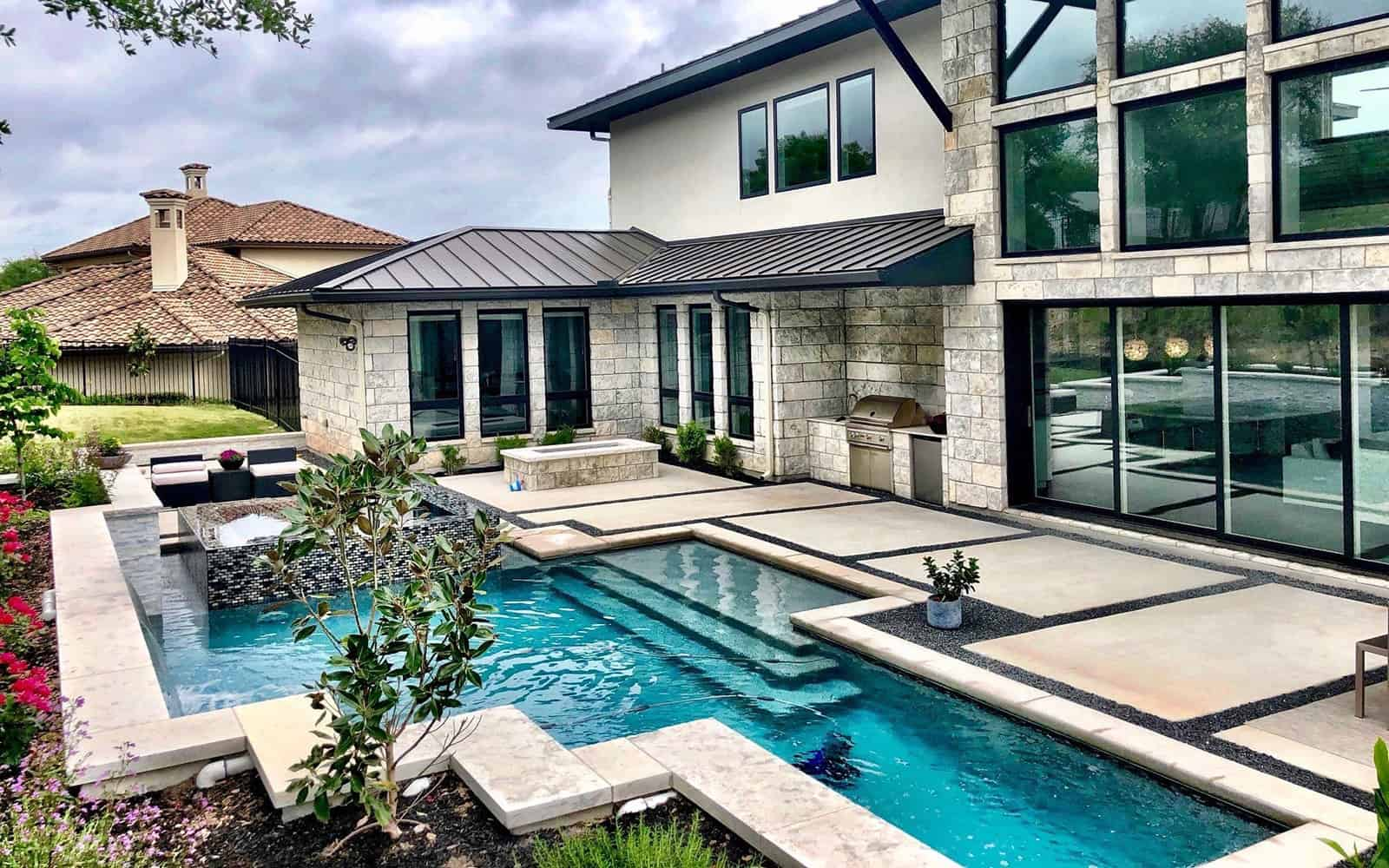 Pool, patio, and outdoor kitchen built by Crescent Homes Maui