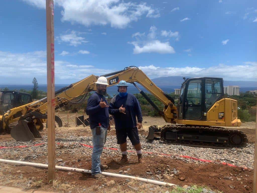 Crescent Homes Maui heavy equipment operators preparing a home site for construction. When you pick the right contractor pick the one with safe operations.