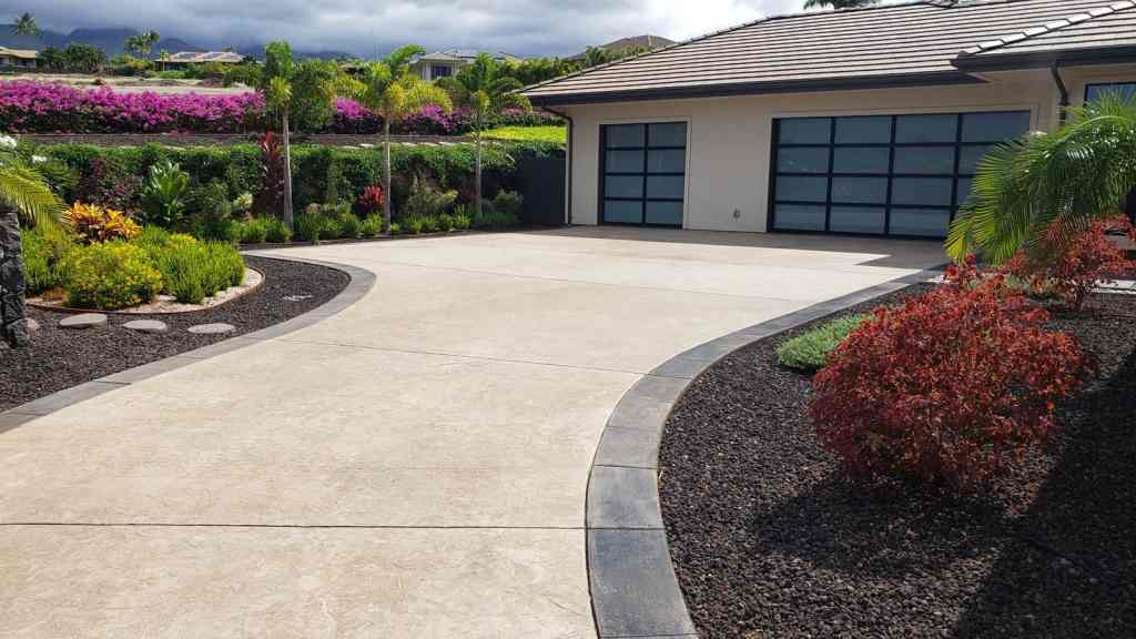 Stamped concrete driveway with concrete border, includes parking and garage