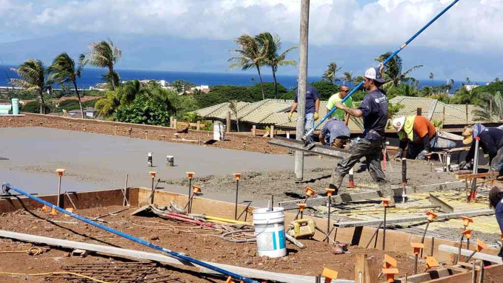 Pouring and finishing concrete is coordinated by our Crescent Homes Maui employees.