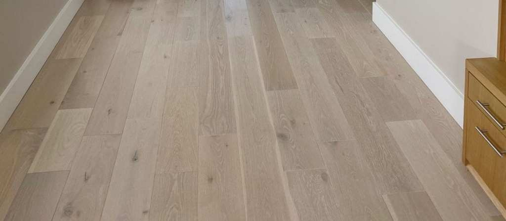 Both beautiful and quiet, a wood floor by Crescent Homes Maui built with sound-dampening