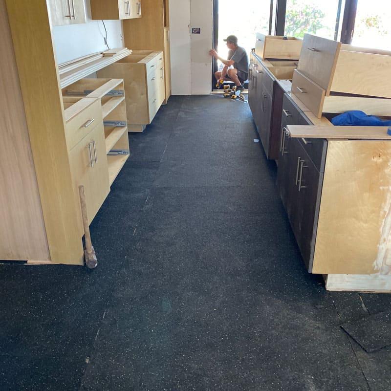 Sound dampening acoustical underlayment and installer