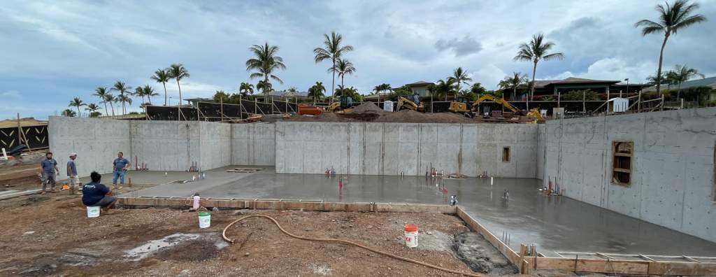 Image of a concrete retaining wall and foundation recently poured