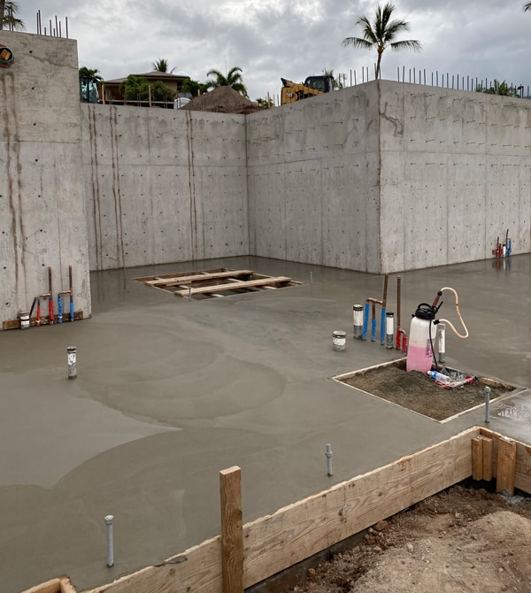 Image of poured concrete foundation of the first floor of a new Maui home