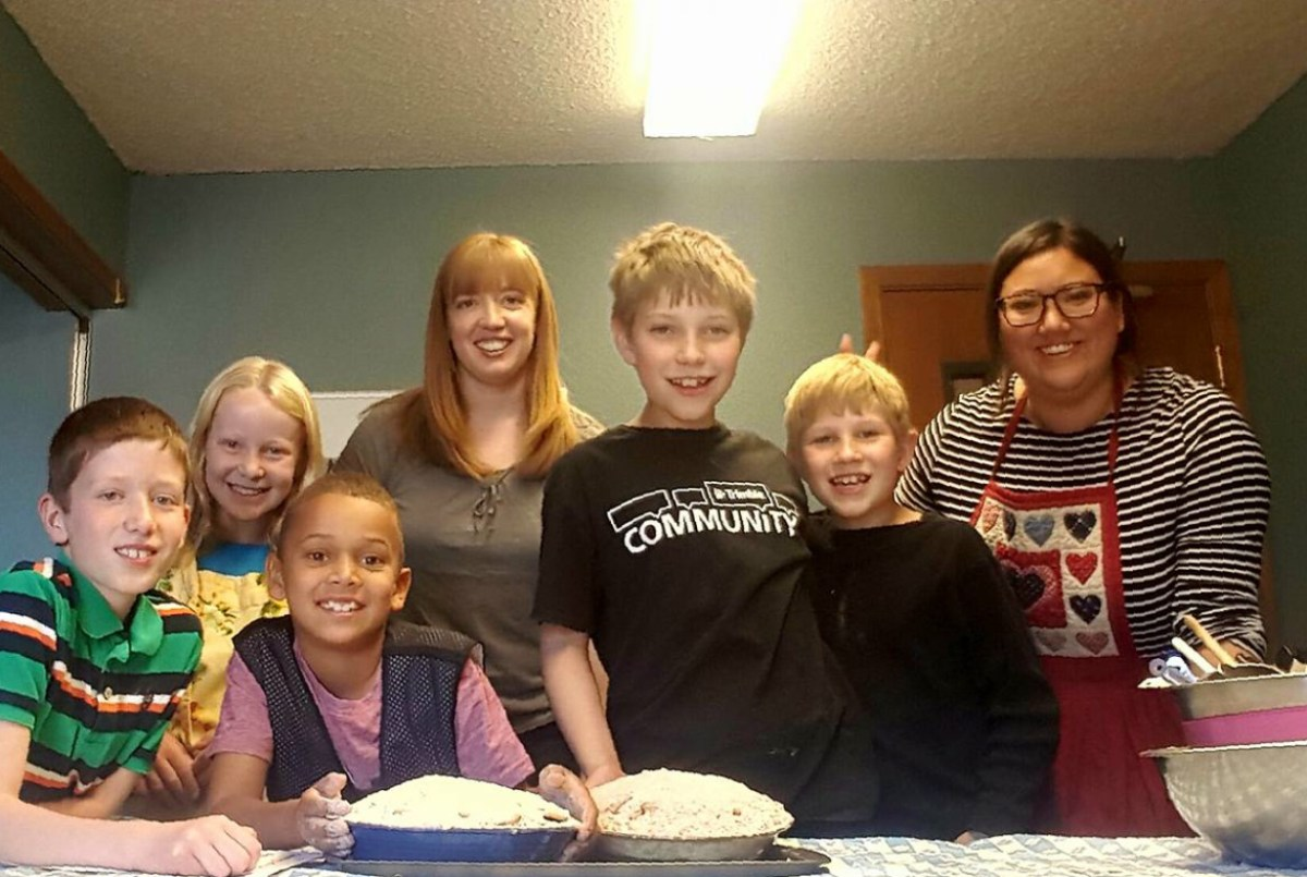 Photo of Crestview kids baking apple pies for the homeless, with teachers Laura and Jackie.
