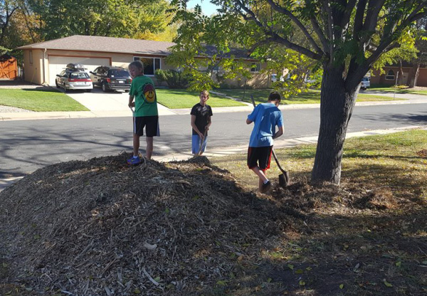 Photo of kids raking leaves.