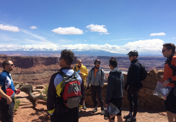 Photo of men at a lookout in Moab during the annual men's retreat.
