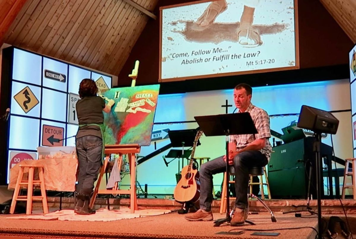 Photo of Pastor Mark and Worship Art's Pastor, Sydney Yapoujian in the sanctuary.