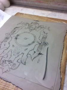 Lastra di argilla con disegno