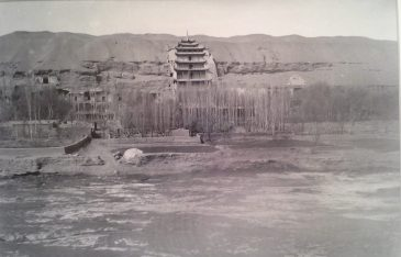 Temples jutting out from stone mark the entrance to the Mogao caves. Image credit: UM museum, Princeton University Lo collection