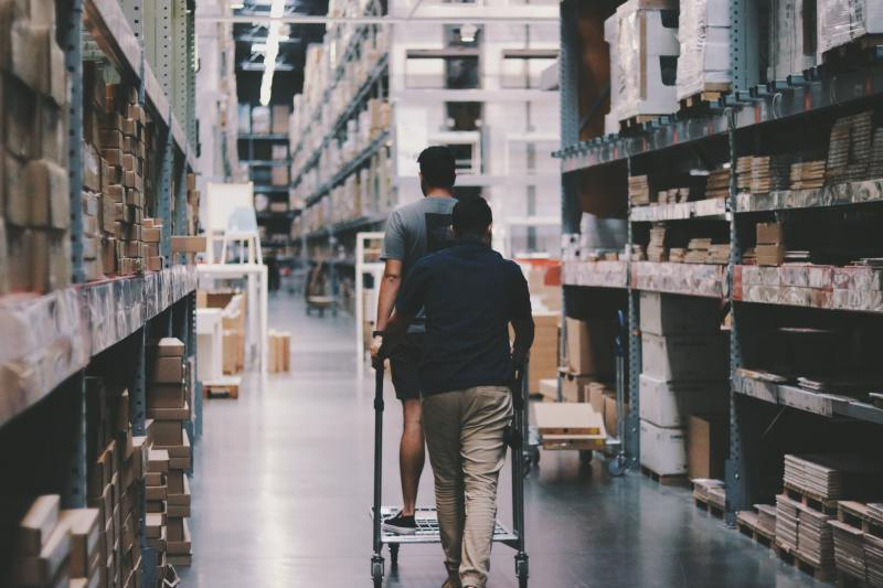 People doing inventory management in a warehouse