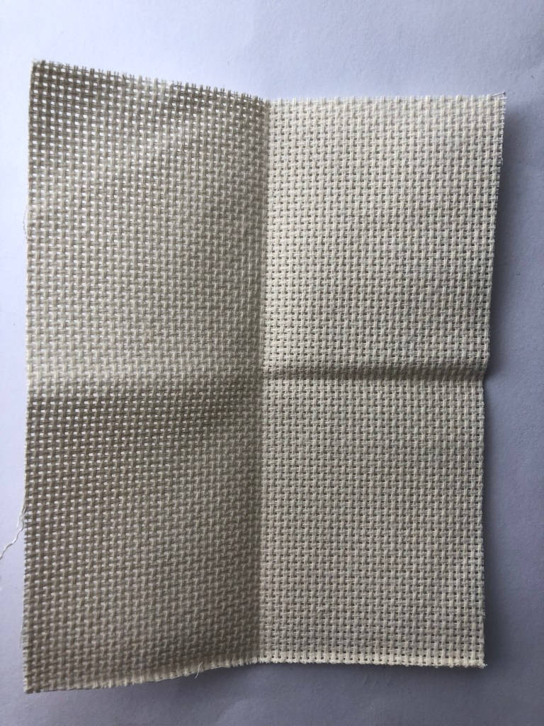 cross stitch fabric folded in half twice