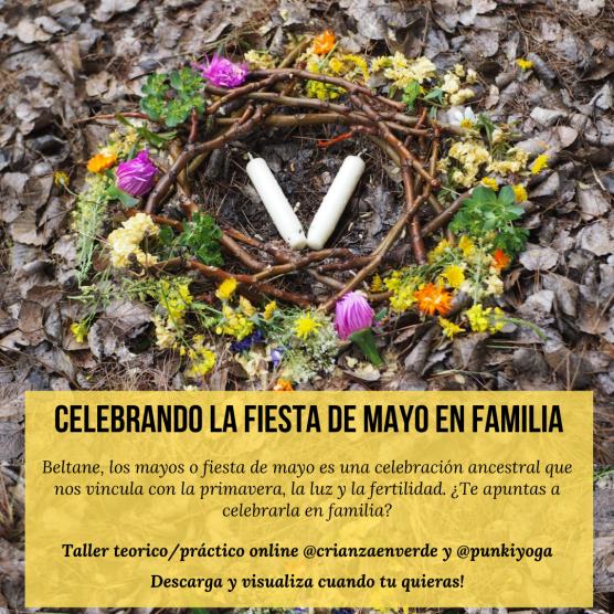 Foto donde se ve un nido rodeado de flores con 2 velas en el medio. Titulo Celebrando la fiest de Mayo en familia