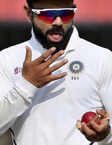 Virat Kholi spitting on cricket ball