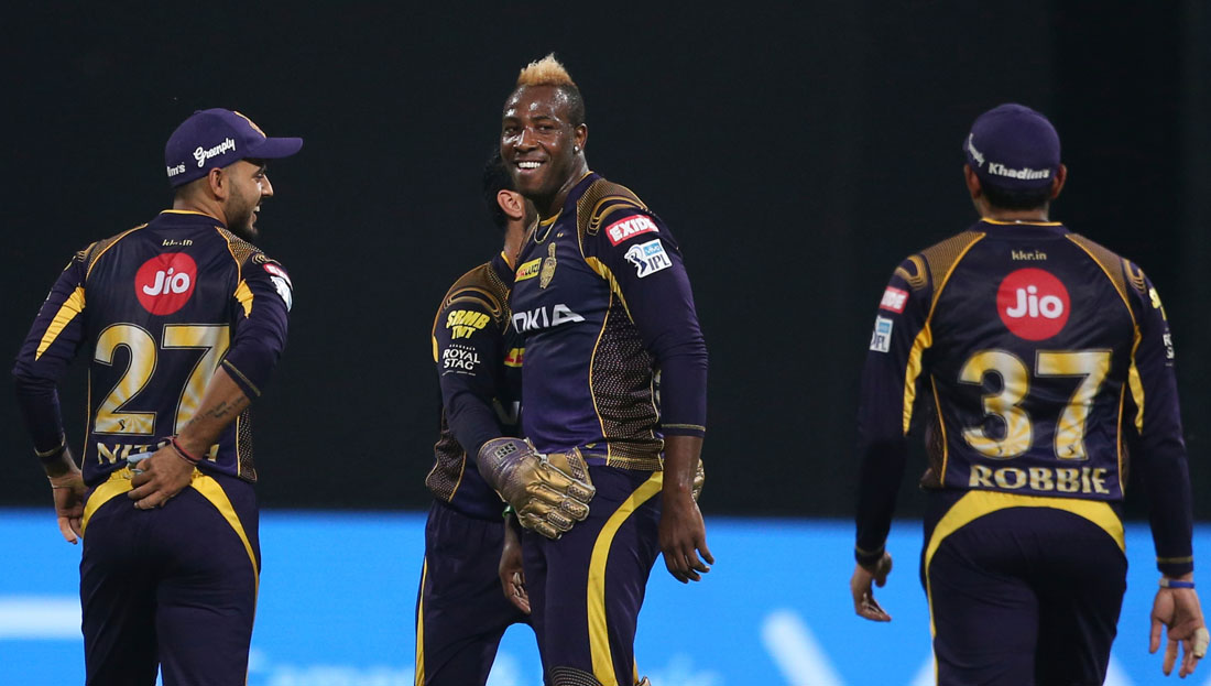 Kolkata Knight Riders' Andre Russell, center, celebrates with teammates the dismissal of Royal Challengers Bangalore batsman Manan Vohra