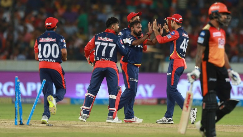 Delhi Daredevils bowler Amit Mishra, centre, celebrates the wicket of Sunrisers Hyderabad Shikhar Drawan